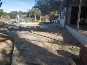 Beautiful pavers swimming pool deck installation by Outdoor Kreations